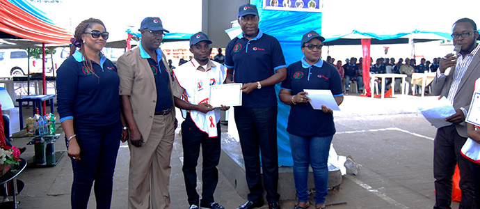 A trained Peer Educator Receiving his certificate