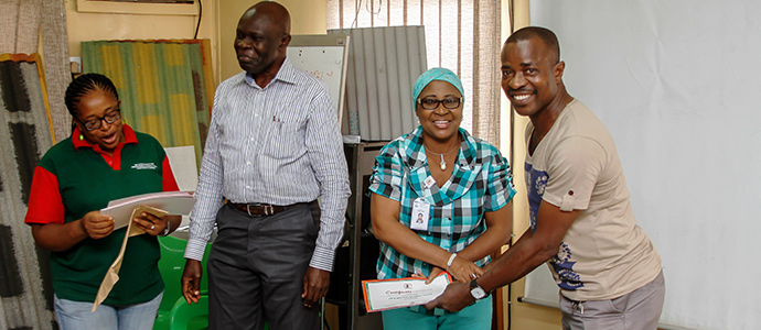 Alhaji Oshikoya, the nursing officer at Nigerite Limited presenting certificate to a participant
